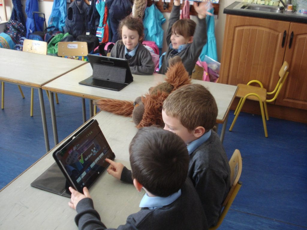 Junior Infants working on the tablets